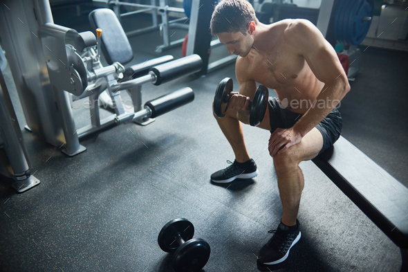 Exercising with Dumbbells - Stock Photo - Images