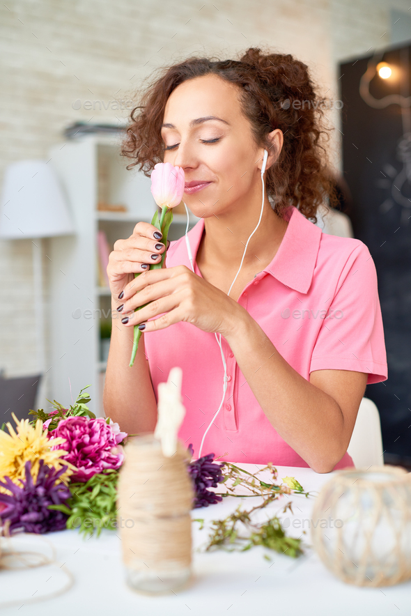 Happy Young Woman Arranging Flowers - Stock Photo - Images