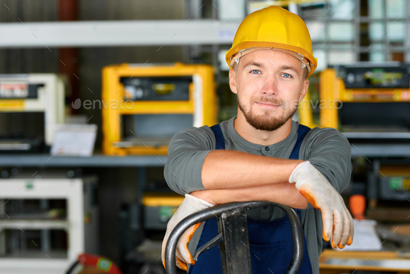 Young Workman Smiling at Camera - Stock Photo - Images