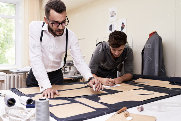 Male Fashion Designers  Making Clothes - Stock Photo - Images