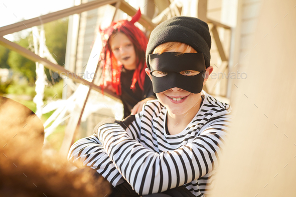 Smiling Little Bandit on Halloween - Stock Photo - Images