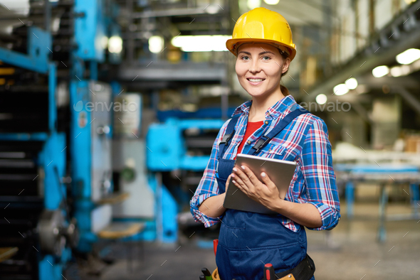 Happy Young Woman at Factory - Stock Photo - Images