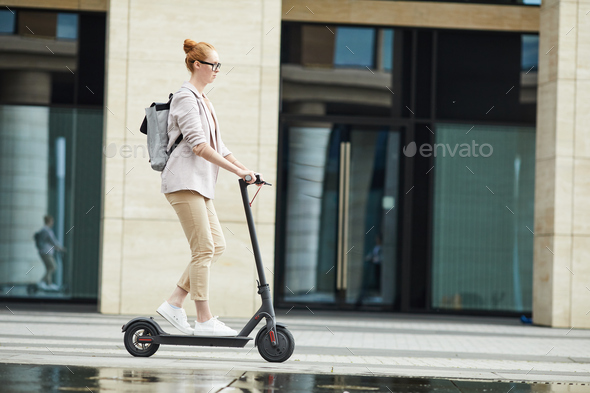 Young Woman Riding Electric Scooter Background - Stock Photo - Images