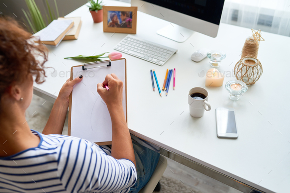 Young Woman Drawing at Home - Stock Photo - Images