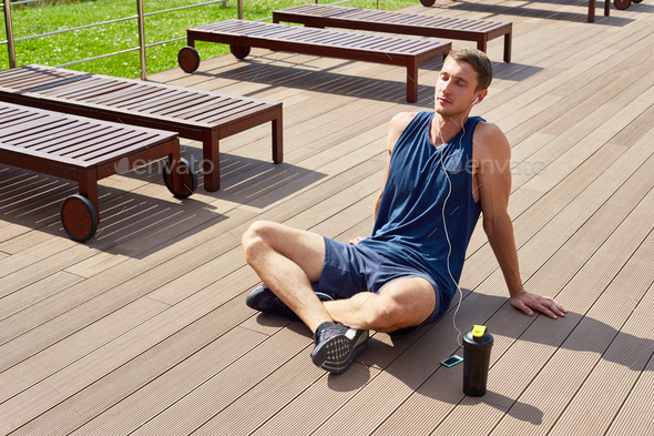 Sportsman Relaxing after Working Out - Stock Photo - Images