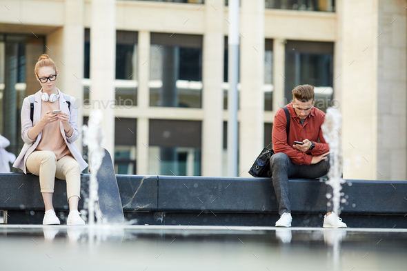 Modern Young People Using Smartphones in City - Stock Photo - Images