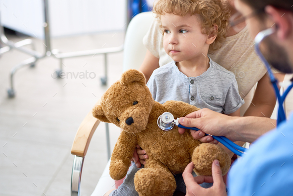 Little Boy Visiting Doctor - Stock Photo - Images