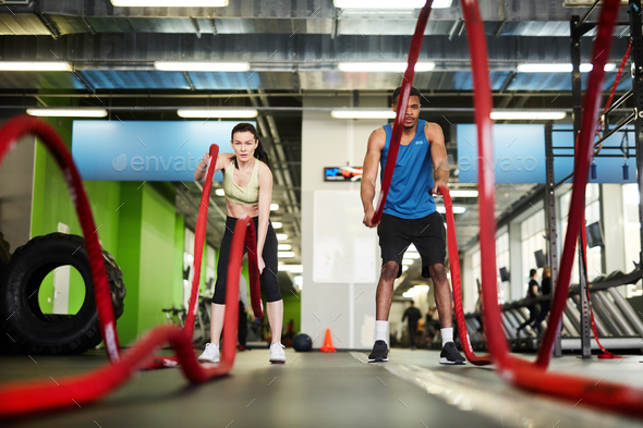 Fit Couple Working Out with Battle Ropes - Stock Photo - Images