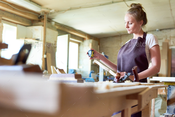Female Carpenter Working in Shop - Stock Photo - Images