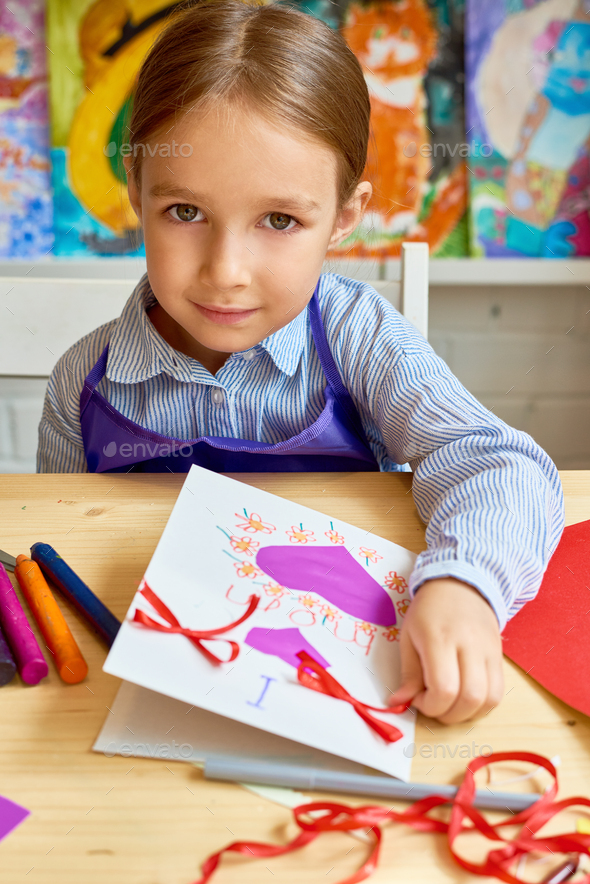 Cute Girl Making Handmade Card for Mom - Stock Photo - Images