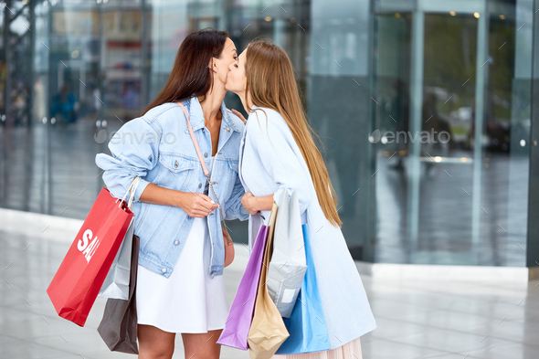 Girl Friends Meeting in Shopping Center - Stock Photo - Images