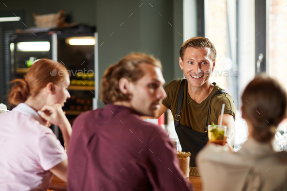 Cheerful Man Enjoying Lunch with Friends in Cafe - Stock Photo - Images