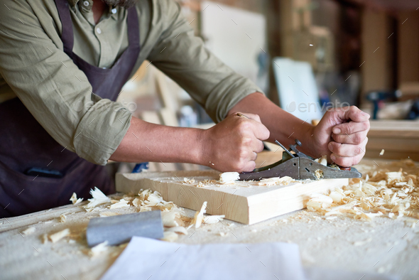 Carpenter Brushing Wood - Stock Photo - Images