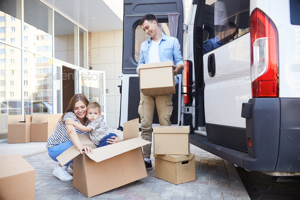 Excited Young Family Moving House - Stock Photo - Images