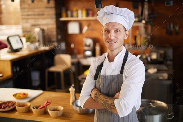Tattooed Chef Posing in Kitchen - Stock Photo - Images