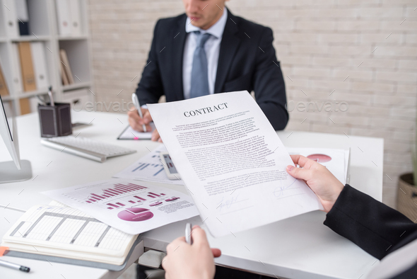 Business Person Reading Contract - Stock Photo - Images