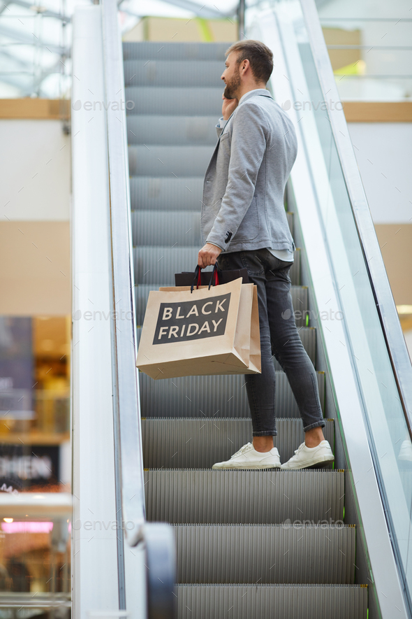 Stylish Businessman Shopping in Mall - Stock Photo - Images