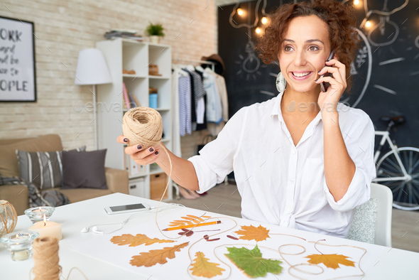 Creative Designer Speaking by Phone - Stock Photo - Images