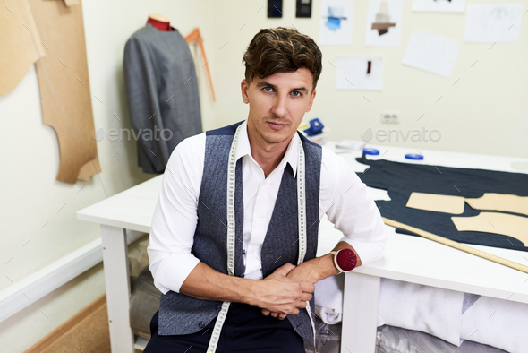 Handsome Fashion Designer Posing in Atelier - Stock Photo - Images