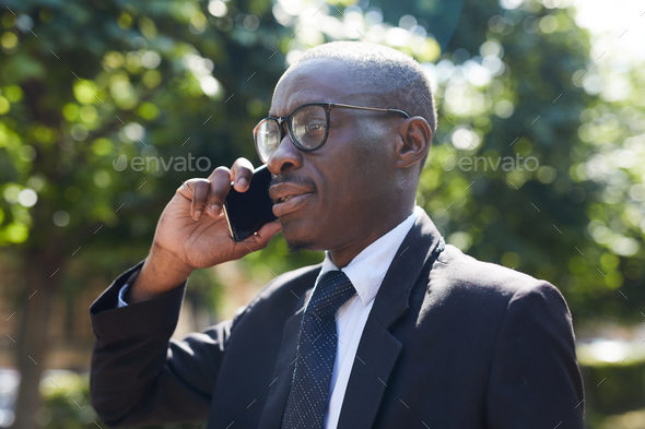 African-American Businessman Speaking by Smartphone - Stock Photo - Images