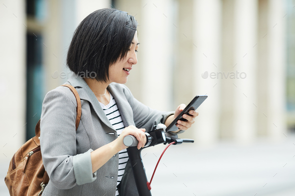 Asian Woman in City - Stock Photo - Images