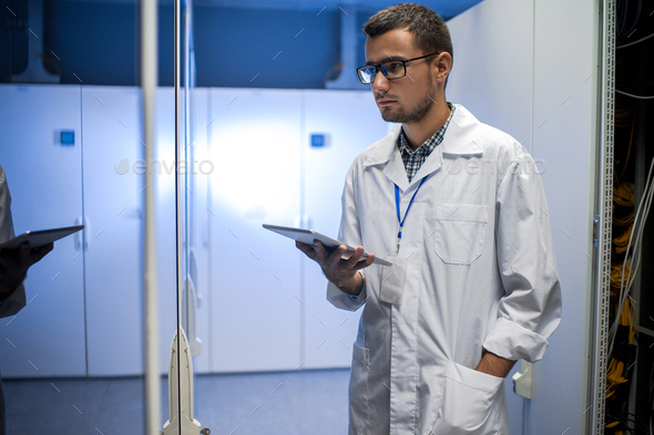 Young Scientist in Data Center - Stock Photo - Images