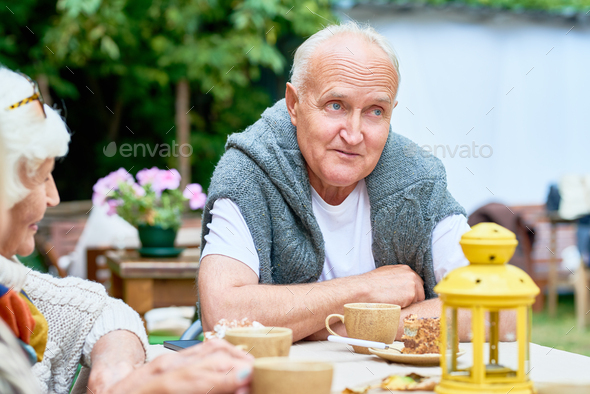 Senior Man Surrounded by Friends - Stock Photo - Images