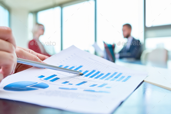 Hand Pointing at Statistics Graph - Stock Photo - Images