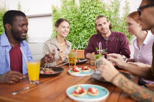 Friends Enjoying Lunch in Cafe - Stock Photo - Images