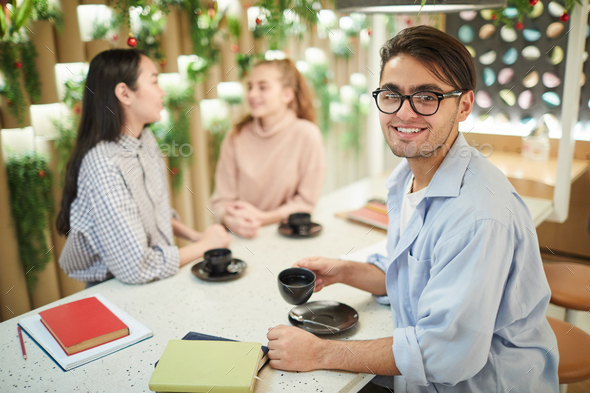 Smiling Mixed-race Student in Cafe - Stock Photo - Images