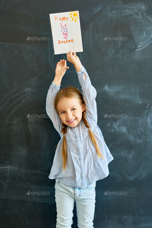 Joyful Little Girl Holding Easter Greeting Card - Stock Photo - Images