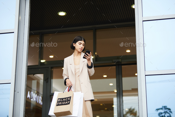 Young Woman Leaving Boutique - Stock Photo - Images