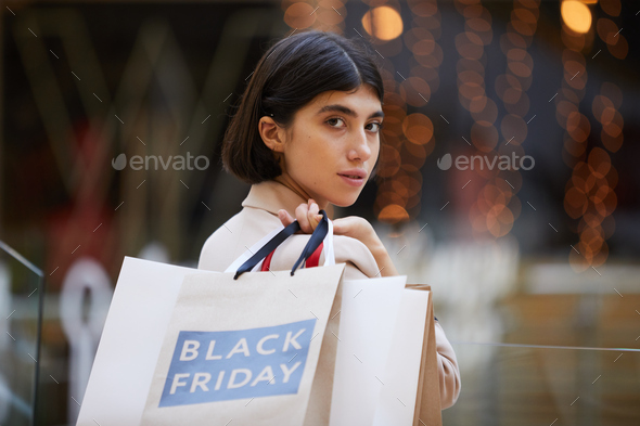 Portrait of Beautiful Woman Holding Shopping Bags - Stock Photo - Images