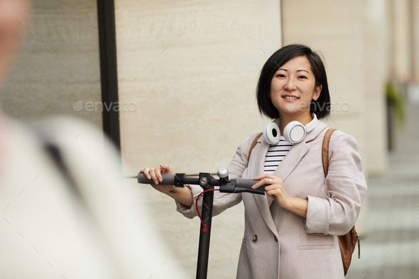 Modern Asian Woman Riding Scooter - Stock Photo - Images