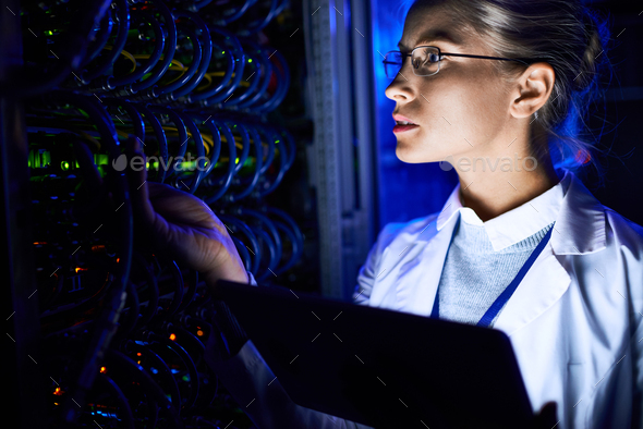 Female Computer Scientist Checking server - Stock Photo - Images