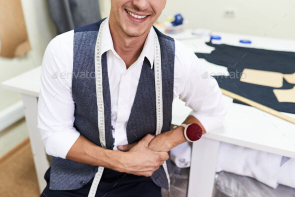 Smiling Tailor in Modern Atelier - Stock Photo - Images