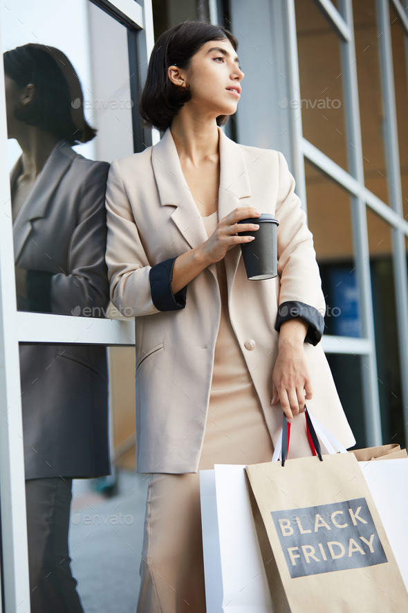 Beautiful Young Woman Leaving Boutique - Stock Photo - Images