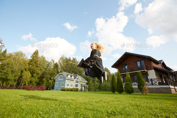 Little Witch Flying on Broomstick - Stock Photo - Images