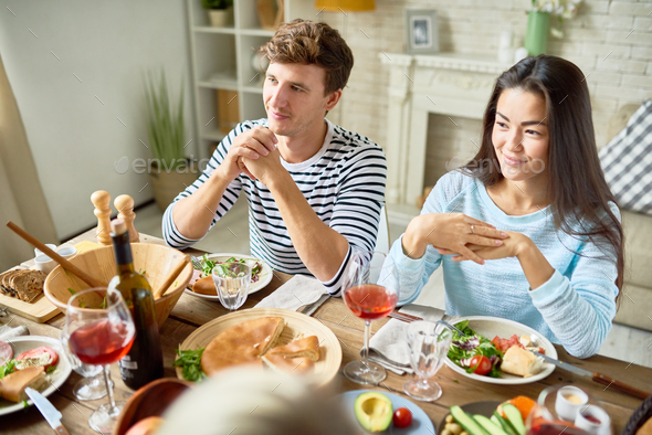 Young Couple at Dinner Table - Stock Photo - Images