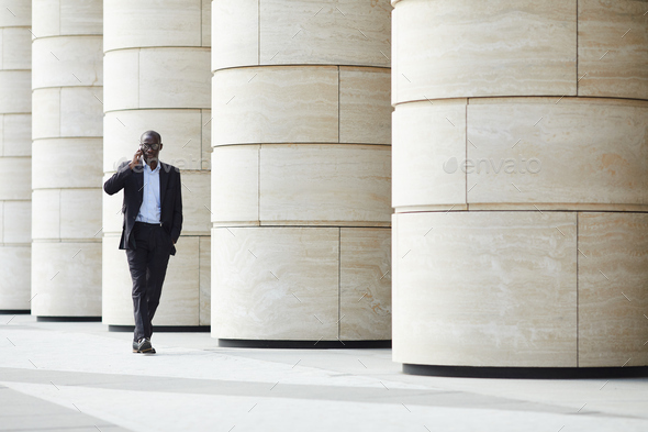 African-American Businessman in City - Stock Photo - Images