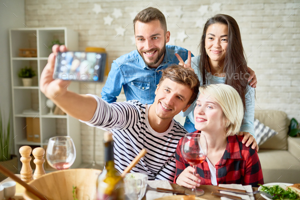 Friend Posing for Selfie at Dinner Party - Stock Photo - Images