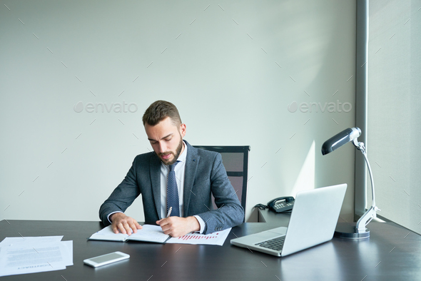 Bearded Entrepreneur Wrapped up in Work - Stock Photo - Images