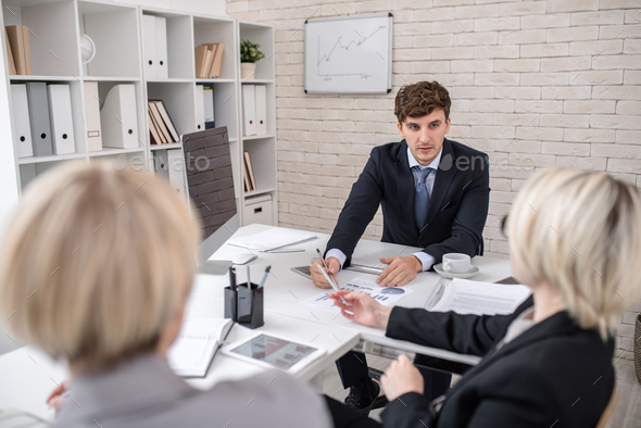 Handsome Man Leading Important Business Meeting in Office - Stock Photo - Images