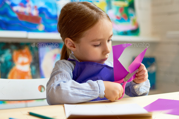 Cute Girl Cutting Out Paper Heart in Craft Class - Stock Photo - Images