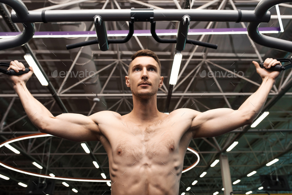 Handsome Man Pumping Arm Muscles - Stock Photo - Images