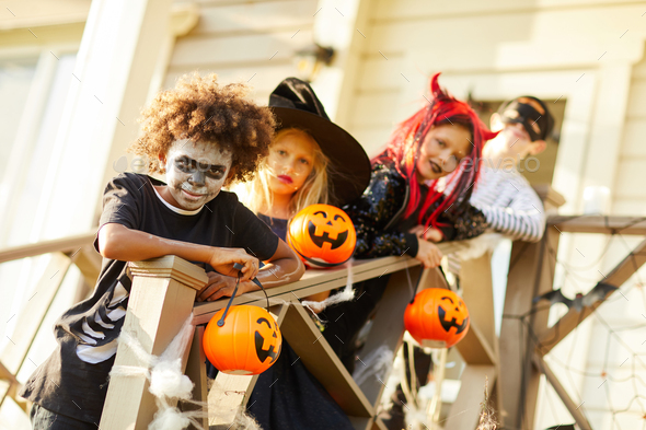 Friends Posing Outdoors on Halloween - Stock Photo - Images