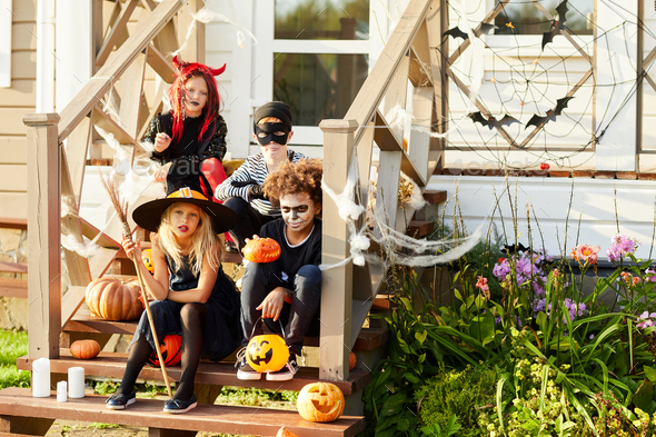 Children in Costumes Posing on Halloween - Stock Photo - Images