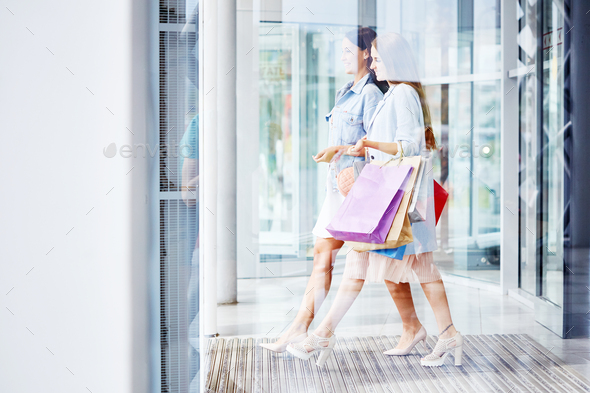 Beautiful Women Leaving Shopping Center with Bags - Stock Photo - Images