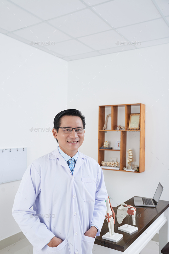 Smiling osteopath - Stock Photo - Images