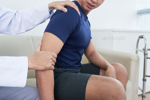 Palpating arm - Stock Photo - Images